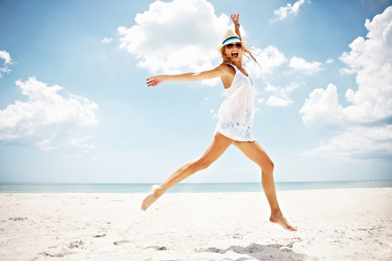 Happy-woman-jumping-on-beach.jpg